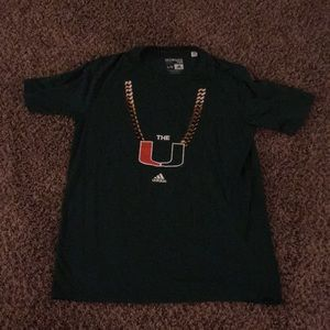 Miami Hurricanes tee, Turnover chain, & necklace
